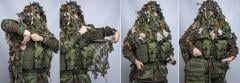 Snigel Design Ghillie Cloak 14. By opening the arm hole press studs you can remove your backpack without doffing the cloak. Really smart!