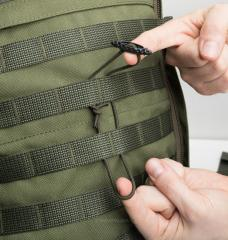 ITW GT Tactical Toggle. A piece of shock cord and a Tactical Toggle can be used to create a super simple tie down system for PALS webbing bases.