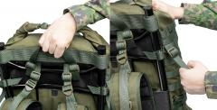 Särmä TST RP80 recon pack. Carry handle straps attached onto the neck area of the frame and sides of the main bag.