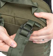 Särmä TST CP15 Combat pack. Pass the webbing back through the slide buckle.