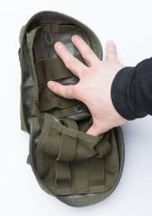 Blackhawk Medical Pouch, green, surplus. Wide elastics towards the body and double-layered elastics on the lid.