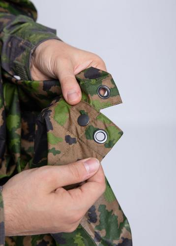Särmä TST Rain poncho, M05 woodland camo. Press studs along the sides for closing up, grommets in all corners and in the middle of all sides for tie down use.