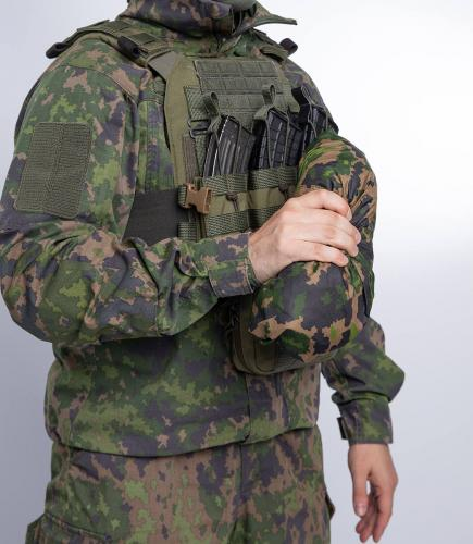 Särmä TST Rain poncho, M05 woodland camo. Pack size - relatively small.