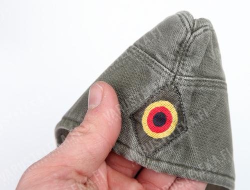 "BW side cap, grey green, surplus. The ""shoot here"" emblem of the West German Bundeswehr. Finns also have a similar roundel in white and blue!"