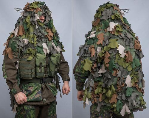 Snigel Design Ghillie Cloak 14. The cloak fits over a medium sized backpack and does not interfere with combat vest pouches.