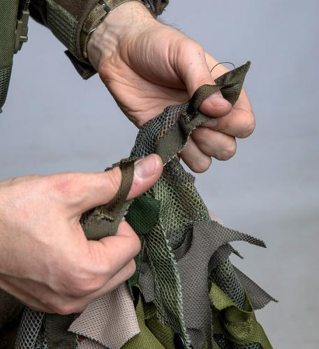 Snigel Design Ghillie Cloak 14. Tie down points in the corners and on the sides.