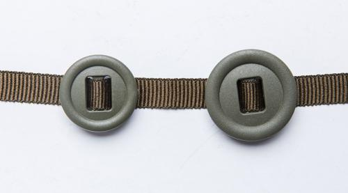 2M Slotted button, 10 pcs. 25 and 30 mm 2M slotted buttons threaded onto the 10 mm button ribbon.