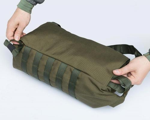 Särmä TST DP10 Roll-Top daypack. The shoulder straps can be tucked away inside the back compartment.