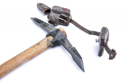 Swiss pickaxe with carrier, surplus. The leather carrier alone must have been silly expensive to make. Pictured also is the chisel-like end meant to cut roots.