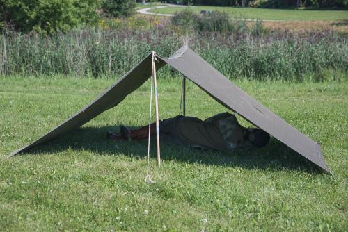 NVA Tent Stake and Pole Set, 30 Piece Set, Surplus. A display of the simplest tent.
